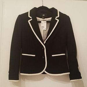 H&M black blazer with white trimming.